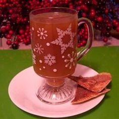 "Hot Buttered Apple Cider | ""Hot apple cider sweetened with maple syrup and topped with butter and spices. A wonderful drink on a cold night or morning. You will have spiced butter left over for your next batch!"""