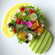 Organic spring salad with curly endive, cucumber, heirloom tomatoes, easter radish, chive blossoms, hooker's onion blossoms, nasturtium, dill, radish microgreens, and maple mustard dressing. #cooking #farmtotable #theartofplating #gastroart #easterradish #radish #microgreens #edibleflowers #chiveblossoms #dill #salad #vegan #heirloomtomatoes #endive #nasturtium #foodporn #healthyeating #organicfood #organic #pnw #seattle #cucumber #tomatoes #nutrition #cleaneating #healthy #curlyendive…