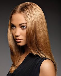 A long blonde straight coloured womens hairstyle