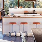 """It was a major decision to put the kitchen in the center where everything would revolve around it,"" says Lazor. ""We did this simply by f..."