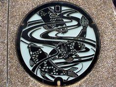 Japanese manhole cover koi family crest
