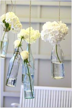 hanging wine bottles and white floral decor