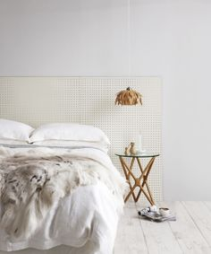 = The pegboard (headboard) is a great spot to hang photos and small artworks.