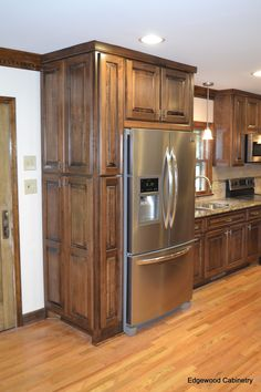 Custom maple cabinets finished in a walnut stain and then a black glaze applied.
