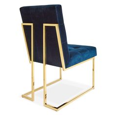 Minimalist Comfort.Pared down geometry in polished brass meets swanky navy velvet in our Goldfinger Collection. A little bit '70s, a lot today. Goldfinger is the winning ticket that adds Modernist rigor to your Park Ave pad or swanks up your Mid-Century abode. Available in luxe natural linen or navy velvet, our Goldfinger Dining Chair looks as good from the back as it does from the front.