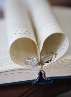 Tip: Tuck two pages of a book to create a perfect heart shape. Photo by Maria Longhi Photography via Style Me Pretty