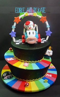 Rainbow Road Mario Kart cake! This is awesome! You can put your favorite character at the top. I would do baby Luigi.