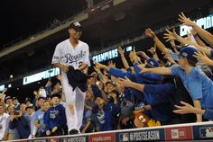 Oct 15, 2014; Kansas City, MO, USA; Kansas City Royals right fielder Norichika Aoki (23) throws a t-shirt into the crowd from the top of the dugout after game four of the 2014 ALCS playoff baseball game against the Baltimore Orioles at Kauffman Stadium. The Royals swept the Orioles to advance to the World Series. (Denny Medley-USA TODAY Sports)