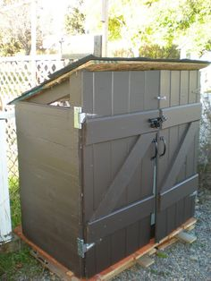 DIY garbage shed for apx $30. Not the most glamorous ever but looks nice and it gets the job done.
