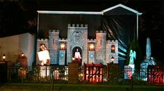 Styrofoam Castle Facade Haunt Display - they covered their house in black tarp.