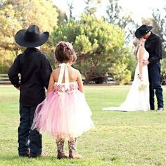 Funny Wedding Photos Our little daughter would love to wear boots with her flower girl dress, just like Mommy will wear with her wedding dress! Western Wedding - Flower girl and ring bearer in foreground, bride and groom in background - precious! Wedding Couples, Trendy Wedding, Wedding Pictures, Perfect Wedding, Dream Wedding, Wedding Day, Wedding Ceremony, Wedding With Kids, Chic Wedding