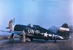 Captain Mahurin of the 56th Fighter Group standing on the port wing of his P-47 Thunderbolt aircraft, conversing with its crew chief, Staff Sergeant John E. Barnes