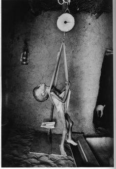 Sebastiao Salgado - A child being weighed