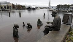 The Kunta Kinte-Alex Haley Memorial sits in flood waters in downtown Annapolis, MD., Tuesday, October 30, 2012, after the superstorm and the remnants of Hurricane Sandy passed through Annaolis. AP Photo/Susan Walsh