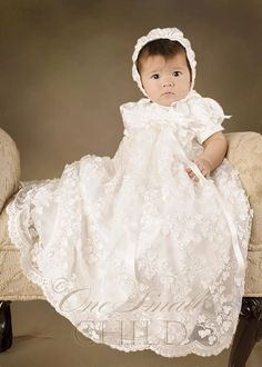 Kennedy Christening Gown: unique shamrock applique embroidery takes this silk christening gown from something sweet to a work of art.