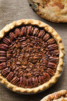 Blue-Ribbon Pecan Pie | This pecan pie's toffee-like interior and beautiful bronze top layer of halved pecans won Rubyane Surritte first place in the pie contest at Oklahoma's Drummond Ranch. This recipe first appeared in our August/September 2013 Heartland issue with the story Big Pie Country. | From: saveur.com