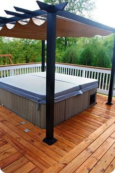 Hot tub and pergola on a wooden deck. Don't forget the swing in the back. Really cute. I like how the deck work goes in different directions.