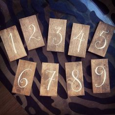 """Walnut-tinted birch table numbers with whimsical handlettering. Size 140x75x14 mm (approx. 55""""x29""""x05""""). #tablenumbers #wooddecoration #diywedding #diybride #teinitsejasäästin #wedding #häät2016 #wood #handlettering #walnut #birch #bohochic #woodtablenumbers #whimsical #rustic #countrystyle #romantic #diy #madebyme #artisan #woodwork #woodworking #woodcraft #woodlandinspired #natural #natureinspired #iirisjanmikael2016 de iiris_h"""