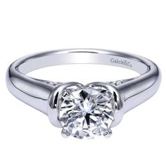 Gabriel & Co. - Two hearts become one forever holding hands in this white gold solitaire setting.