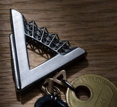 A stylish 3D printed keychain with a smart twist. Adding and removing items from the keychain now only takes a second. Designed by Barney Mason. 3D printed in High Detailed Stainless Steel and Bronze. #3dprint  #3dprinting #3dmodeling #keychain #stainlesssteel #bronze #DIY