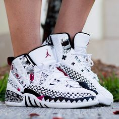 "The Air Jordan 12 ""Danzo"" customs by Specified Fiction see black graphics that plague the white base model, with sharp, pink accents present all over."