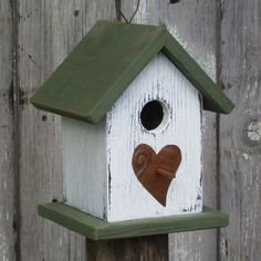 I adore birdhouses!  Especially when birds are in them!