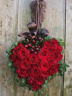 Rose heart on a heart- shaped grapevine wreath