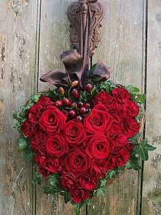 Rose heart on a heart- shaped grapevine wreath