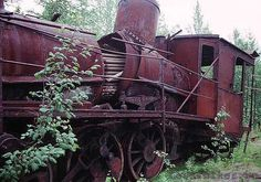 """Abandoned steam locomotive in Abkhazia.  From English Russia: """"We've had recently an abandoned railway in Abkhazia, abandoned as a result of USSR collapse when new """"independent"""" republics couldn't maintain the complicated and high-cost USSR legacy objects. But this one was abandoned long before the USSR collapse, it was doomed to be abandoned from the beginning. It was built by a personal Stalin's order in the middle of nowhere – deep inside Northern Siberia between Salekhard city and…"""