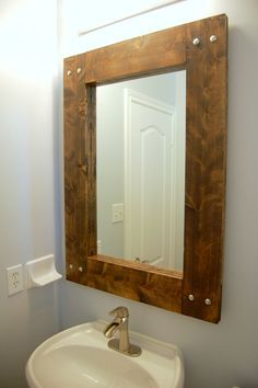 DIY Rustic Mirror | northstory.ca #farmhouse mirror Use a thicker bottom piece and use it as a ledge