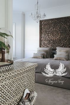 Manyara Home - Bedroom Minus the chandelier, I love this. That wooden wall art makes me happy - http://www.homedecoz.com/home-decor/manyara-home-bedroom-minus-the-chandelier-i-love-this-that-wooden-wall-art-makes-me-happy/