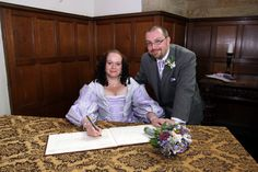 Signing the register in Chirk Castle's Chapel