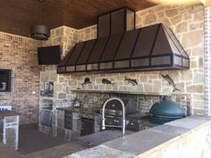 Hand Crafted Custom Brushed Finish Stainless Steel Vent Hood with Wrought Iron Bands and three blower units with lights over outdoor grill #outdoordesign #outdoorkitchen #ventilationhoods #customhomes #countrystyle #outdoorliving #countryliving #FarmHouseStyle #RanchHomes #beachsheetmetal