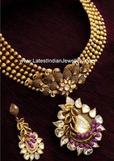 Unique designer 22 karat gold necklace in dull antique finish looks trendy and beautiful. The gold beaded neck chain paired with classy designer pendant Gold Earrings Designs, Gold Jewellery Design, Necklace Designs, Gold Jewelry, Gold Necklace, Antique Necklace, Diamond Jewellery, Simple Necklace, Indian Wedding Jewelry