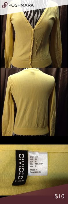 Super Soft Yellow Cardigan by Divided Size 8 This lightweight yellow long-sleeve cardigan is a super soft cotton/poly blend. V-neck, button front, ribbed cuffs and bottom. The perfect little cover up for those cool summer evenings or air-conditioned office. Size 8, by Divided, an H&M brand. Divided Sweaters Cardigans