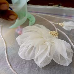 Adding leaves to the silk organza flower appliques design. to perfect fabric manipulation on the Tambour Embroidery, Couture Embroidery, Silk Ribbon Embroidery, Embroidery Jewelry, Embroidery Flowers Pattern, Flower Applique, Hand Embroidery Designs, Applique Designs, Embroidery Kits