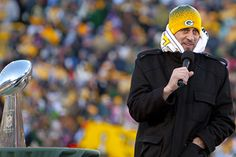 Aaron Rodgers celebrating XLV victory at Lambeau in single digit temperatures.
