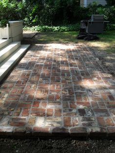 reclaimed brick patio - reminder to reuse the bricks from the old stack chimney