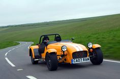 Caterham Lotus Super Seven, only with British Green racing stripes- so fast at acceleration it makes your cheeks go wobbly!
