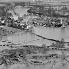 The River Thames flood covering South Field, the Eton Railway Viaduct and South Meadow, Eton, 1929 | Britain from Above