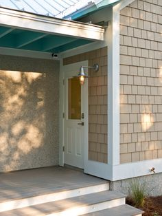 The boathouse-style garage area provides space to unload the car after a day at the beach, store gear, rinse off and refresh before entering the home via a secondary side entrance.
