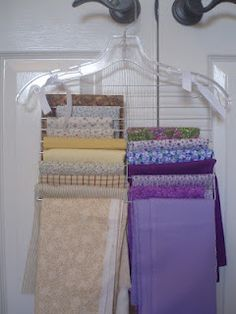Material Hangers-tie a dollar store cooling rack to a clothes hanger-easy to see what fabric (or scarves, ties, maybe skirts) you have, keeps it neat and wrinkle-free!