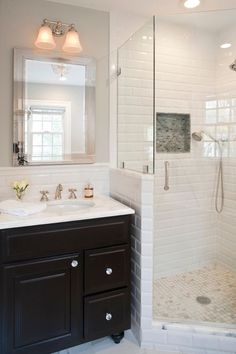 Charming Subway Tiled Shower Image Gallery in Bathroom Traditional design ideas with Charming beveled subway tile black and white corner shower crystal knobs frameless glass