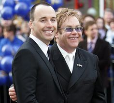 Elton John & David Furnish at their Civil Partnership in December 2005. Re-pinned by Woolton & Hewitt specialists in gay & lesbian engagement & wedding rings www.wooltonandhewitt.co.uk