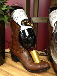 Cowboy boot wine bottle holder. Too fun!
