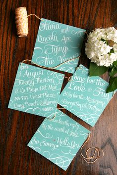 Bunting wedding invitation in mint. Typography by PaperStreetPress