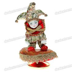 Material: porcelain + cotton + cloth + plastic - Works great and playing the song perfectly - Rotated the bottom of the music box, it would spin gently and play wonderful music - Ideal for decoration and a perfect gift / Valentines gift http://j.mp/1q1rf9Y