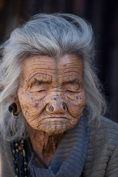 Apatani - Arunachal Pradesh, India ~ a part of India not seen - large nasal piercings, large ear piercings, and gray facial markings We Are The World, My People, People Around The World, Old Faces, Face Photo, Human Emotions, Perfect World, Interesting Faces, Portraits