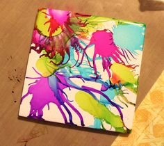alcohol ink and canned air on tiles