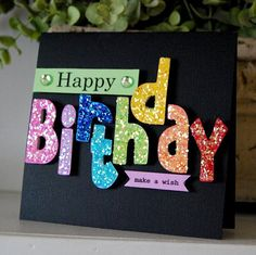 Bright Birthday letters!  Love the chunky glitter used on matching color cardstock.  The bright colors and the pop up letters look great on the black background.  DIY birthday card.
